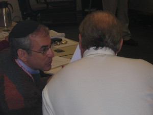 Harvey Schabes leans in to discuss part of a PDR with CalTech instructor Joel Sercel.