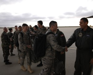 Maj. Santos Munoz, Joint Functional Component Command for Space, and other Vandenberg leadership give farewells to airmen boarding a C-5 Galaxy headed to McGuire AFB, NJ, on February 15. Thirty-six airmen from the 30th Space Wing were deployed in support of Joint Task Force Burnt Frost.