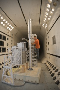Thomas Ivanco prepares a model of Ares I-X for testing in the Transonic Dynamics Tunnel at NASA's Langley Research Center.