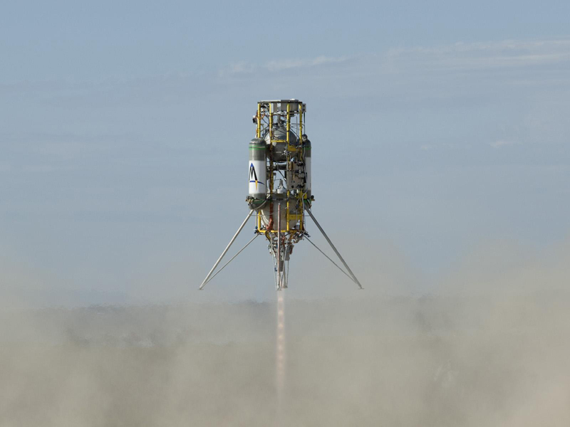 "Masten Space Systems' ""Xombie"" vehicle ascending during its first flight."