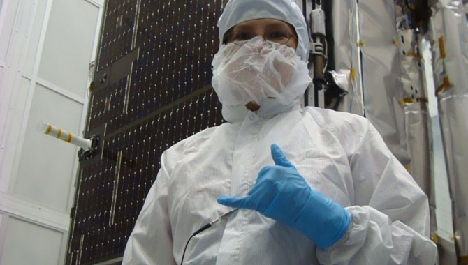 LRO Deputy Project Manager Cathy Peddie stands in front of LRO in a clean room.