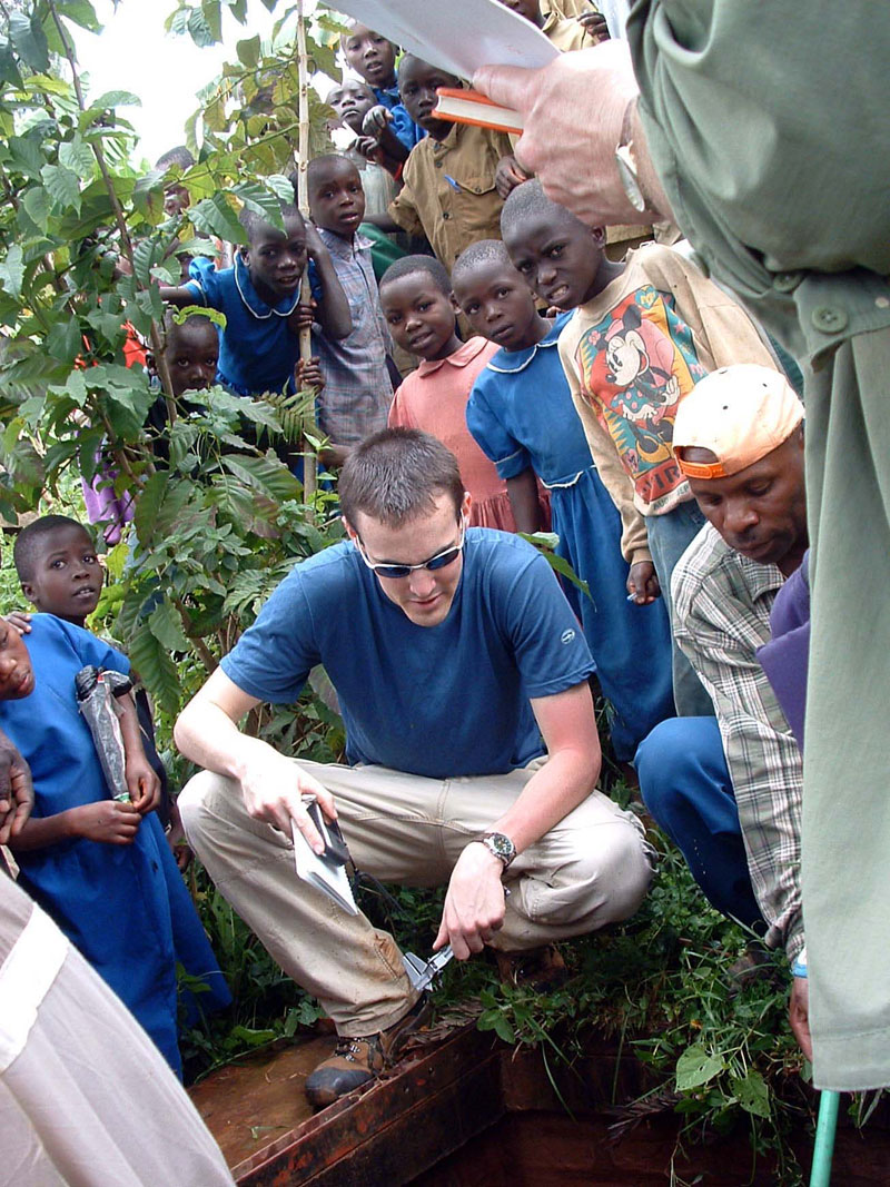 EWB-JSC volunteer Evan Thomas working in Muramba, Rwanda, to assess a surface-water pipeline.
