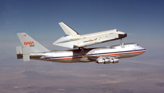 The Space Shuttle prototype Enterprise rides smoothly atop NASA's first shuttle carrier aircraft, NASA 905, during the first of the shuttle program's approach and landing tests at Dryden Flight Research Center in 1977.