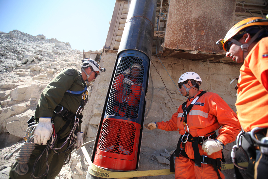 Rescue workers practice a dry run with one of the capsules used to liberate the trapped miners at the San Jose mine near Copiapo, Chile, on October 11, 2010.