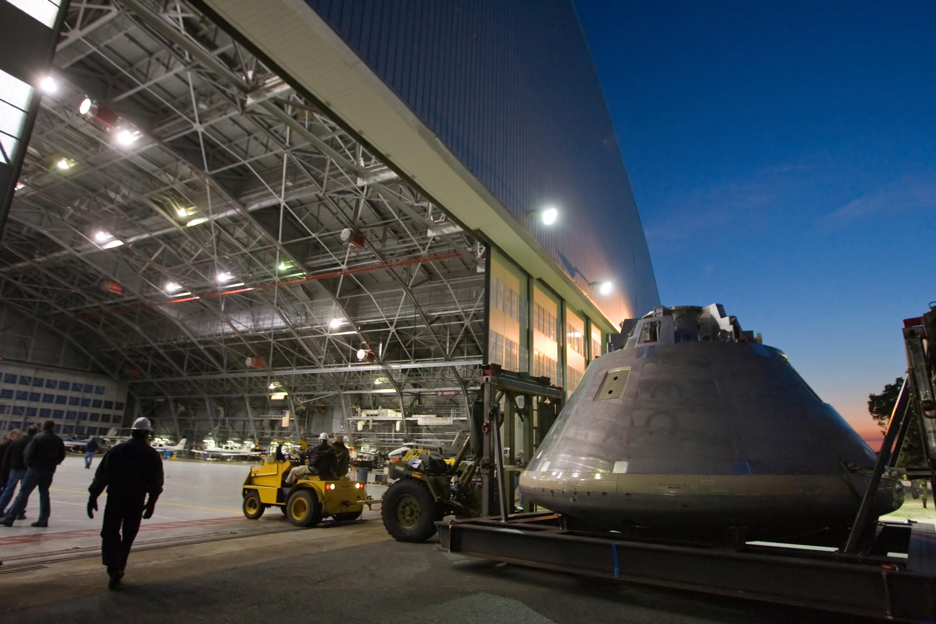 A mock-up of the Orion space capsule heads to its temporary home in a hangar at Langley Research Center.