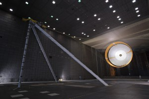 The parachute for NASA's Mars Science Laboratory (MSL) being tested inside the world's largest wind tunnel at Ames Research Center. An engineer is dwarfed by the parachute, the largest ever built to fly on an extraterrestrial flight.