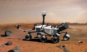 Artist's concept of the Mars Science Laboratory in Martian terrain.