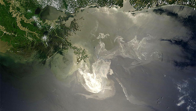 Sunlight illuminated the lingering oil slick off the Mississippi Delta on May 24, 2010. Photo Credit: NASA