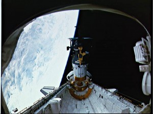 During STS-34, the Galileo spacecraft atop the inertial upper stage is deployed from Atlantis's payload bay.