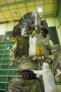 An engineer looks on as the stacked STEREO spacecraft undergo a spin balance test.