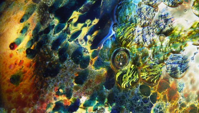"""Close-up detail of the surface of one of Josh Simpson's glass """"Planet"""" sculptures."""