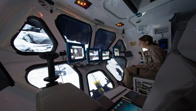 Liz Rampe, a planetary geologist and postdoctoral researcher, pilots the Multi-Mission Space Exploration Vehicle (MMSEV) down to asteroids spinning at different rates as part of the 2012 Research and Technology Studies (RATS) at Johnson Space Center.
