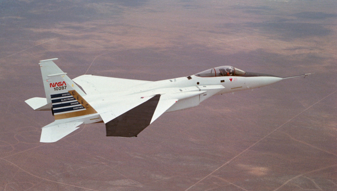 Digital Electronic Engine Control F-15A #287 in flight over California City. Note wing deflection measurement system on right wing. June 18, 1982