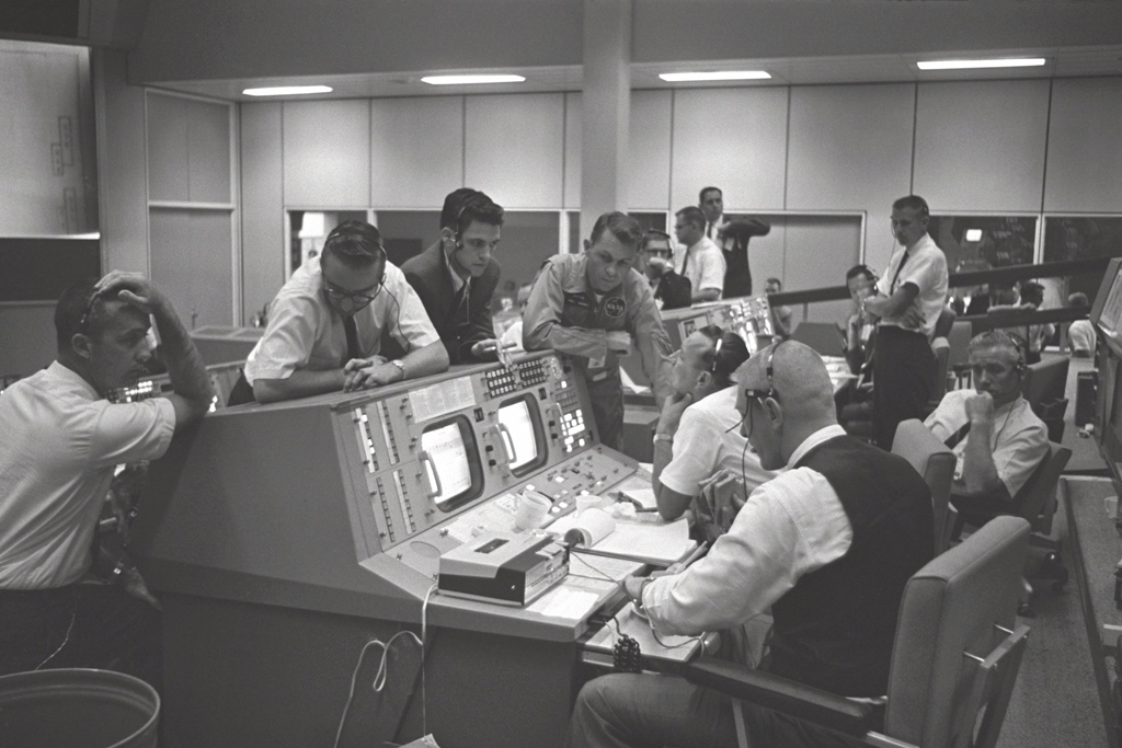 Flight Director Gene Kranz (foreground) and Dr. Christopher Kraft (background) in the Mission Control Center in Houston, Texas, during the Gemini 5 flight.