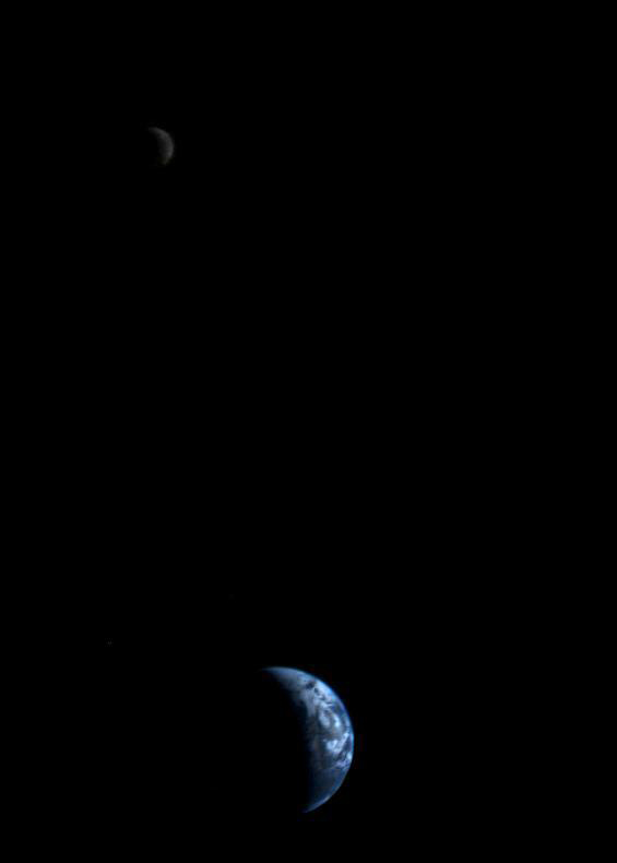 This picture of a crescent-shaped Earth and Moon — the first of its kind ever taken by a spacecraft — was recorded Sept. 18, 1977, by NASA's Voyager 2 when it was 7.25 million miles (11.66 million kilometers) from Earth. Voyager 2 was launched on Aug. 20, 1977, 16 days before its twin, Voyager 1.