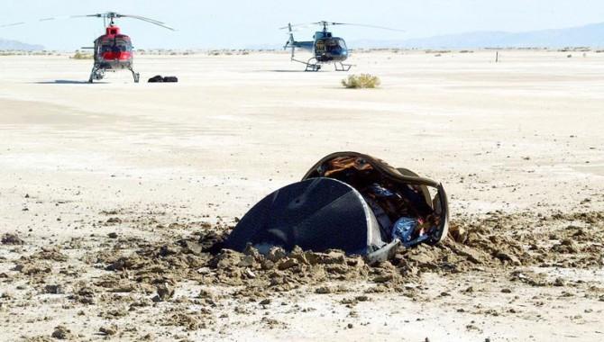 The Genesis sample return capsule crash-landing in the Utah desert.