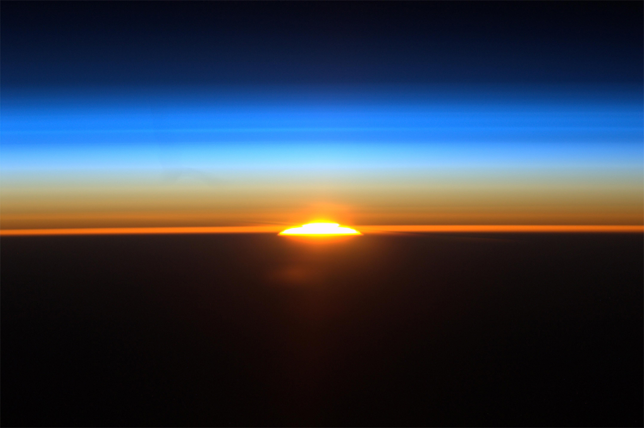 On Saturday, Aug. 27, 2011, International Space Station astronaut Ron Garan used a high definition camera to film one of the sixteen sunrises astronauts see each day. This image shows the rising sun as the station flew along a path between Rio de Janeiro, Brazil and Buenos Aires, Argentina.