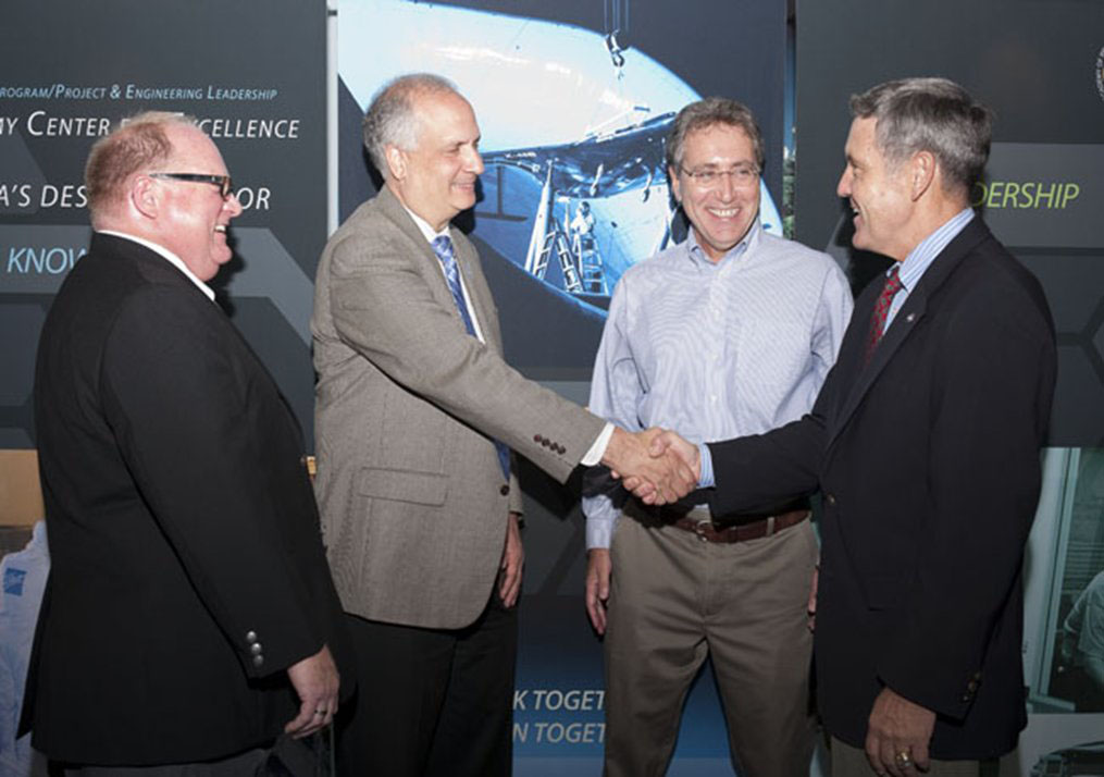 NASA APPEL Director Dr. Ed Hoffman shakes hands with Kennedy Space Center Director Bob Cabana. (From left to right: Stephen Angelillo, ACE Director, Ed Hoffman, APPEL Deputy Director Roger Forsgren, Bob Cabana.)
