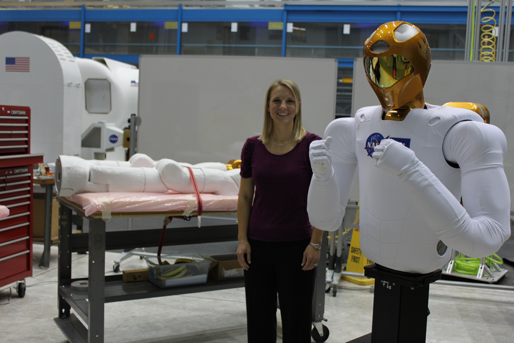 C.J. Kanelakos, mechanical engineer at Johnson Space Center, with the R2 torso and legs on the table in the background.