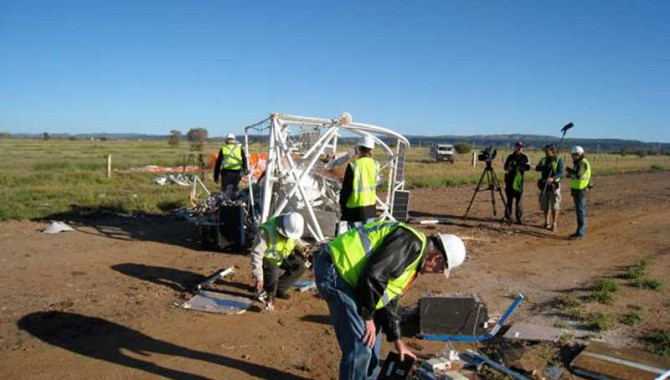 Project personnel inspect damage following a NASA scientific balloon launch mishap on April 28 at the Alice Springs Balloon Launching Center, near Alice Springs, Australia.