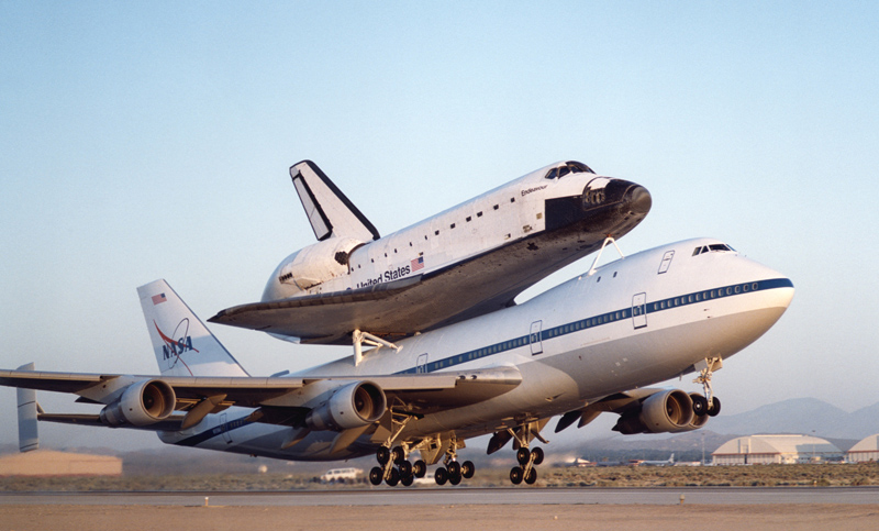 NASA's modified Boeing 747 Shuttle Carrier Aircraft with the Space Shuttle Endeavour on top lifts off to begin its ferry flight back to the Kennedy Space Center in Florida.