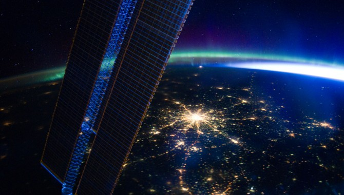 Moscow appears at the center of this nighttime image photographed by the Expedition 30 crew aboard the International Space Station, flying at an altitude of approximately 240 miles on March 28, 2012. A solar array panel for the space station is on the left side of the frame. The view is to the north-northwest from a nadir of approximately 49.4 degrees north latitude and 42.1 degrees east longitude, about 100 miles west-northwest of Volgograd. The Aurora Borealis, airglow and daybreak frame the horizon.