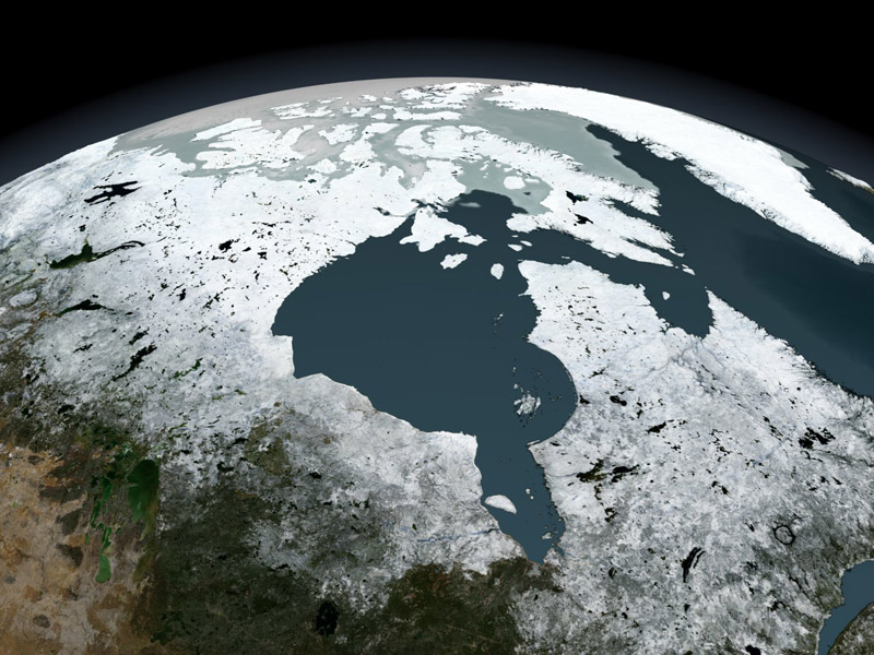 Over the course of a year, sea ice in northern Canada pulsates down into the Hudson Bay and retreats northward in the summer months. In the winter months where the sea ice extends down into the bay, polar bears wander onto the ice in search of food. As summer approaches and the sea ice melts, the bears wander back onto the mainland until the next winter.