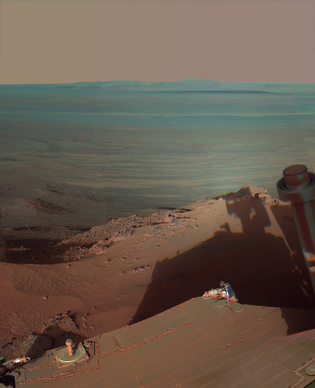 NASA's Mars Rover Opportunity catches its own late-afternoon shadow in this dramatically lit view eastward across Endeavour Crater on Mars.