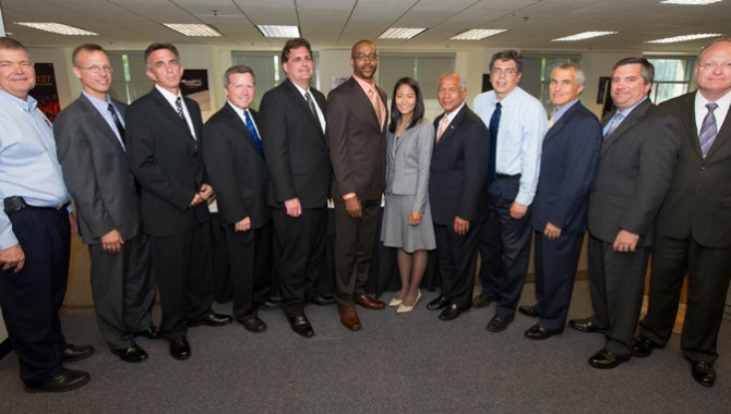 Class photo of the 2012 Systems Engineering Leadership Development Program (SELDP) graduates with NASA Chief Engineer Mike Ryschkewitsch (far left), Boeing Chief Engineer Paul Lambertson (second from left), and NASA Administrator Charlie Bolden (center).