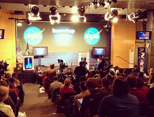 The audience waits for Astronaut Ron Garan to appear at a NASA Headquarters Tweetup in on February 15, 2012.