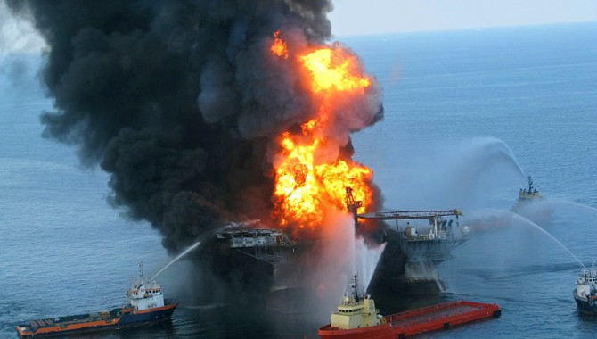 Platform supply vessels battle the blazing remnants of the off shore oil rig Deepwater Horizon. A Coast Guard MH-65C dolphin rescue helicopter and crew document the fire aboard the mobile offshore drilling unit Deepwater Horizon, while searching for survivors. Multiple Coast Guard helicopters, planes and cutters responded to rescue the Deepwater Horizon's 126 person crew.
