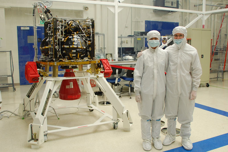 Josephine Santiago-Bond and her husband Chris stand next to the Lunar Atmosphere and Dust Environment Explorer (LADEE) propulsion structure at Ames Research Center.