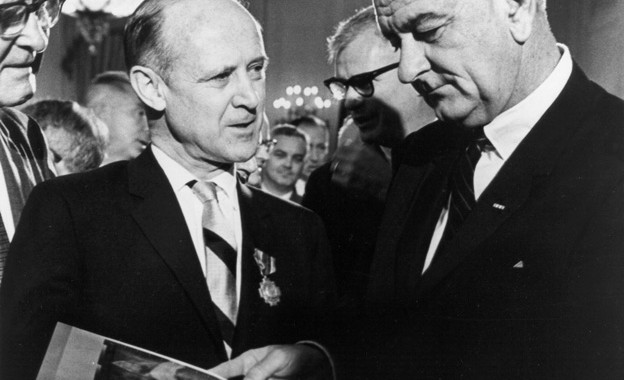 Dr. William H. Pickering (left), Director of the Jet Propulsion Laboratory, presents Mariner spacecraft photos to President Lyndon Baines Johnson in 1964.
