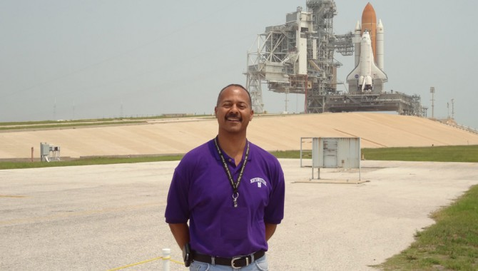Michael Bell, KSC Chief Knowledge Officer, standing in front of Atlantis before her last launch, STS-135, and the last mission of the Space Shuttle Program.