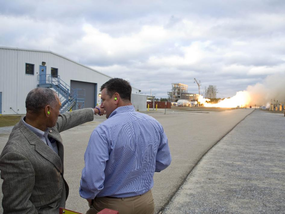 NASA Administrator Charlie Bolden (left) and Stennis Space Center Director Patrick Scheuermann view a test firing of the first Aerojet AJ26 flight engine. Once flight acceptance is achieved, the engine will power the first stage of Orbital's Taurus II space launch vehicle on commercial cargo missions to the International Space Station. NASA has partnered with Orbital to provide eight cargo missions to the space station, with the first scheduled for early 2012.