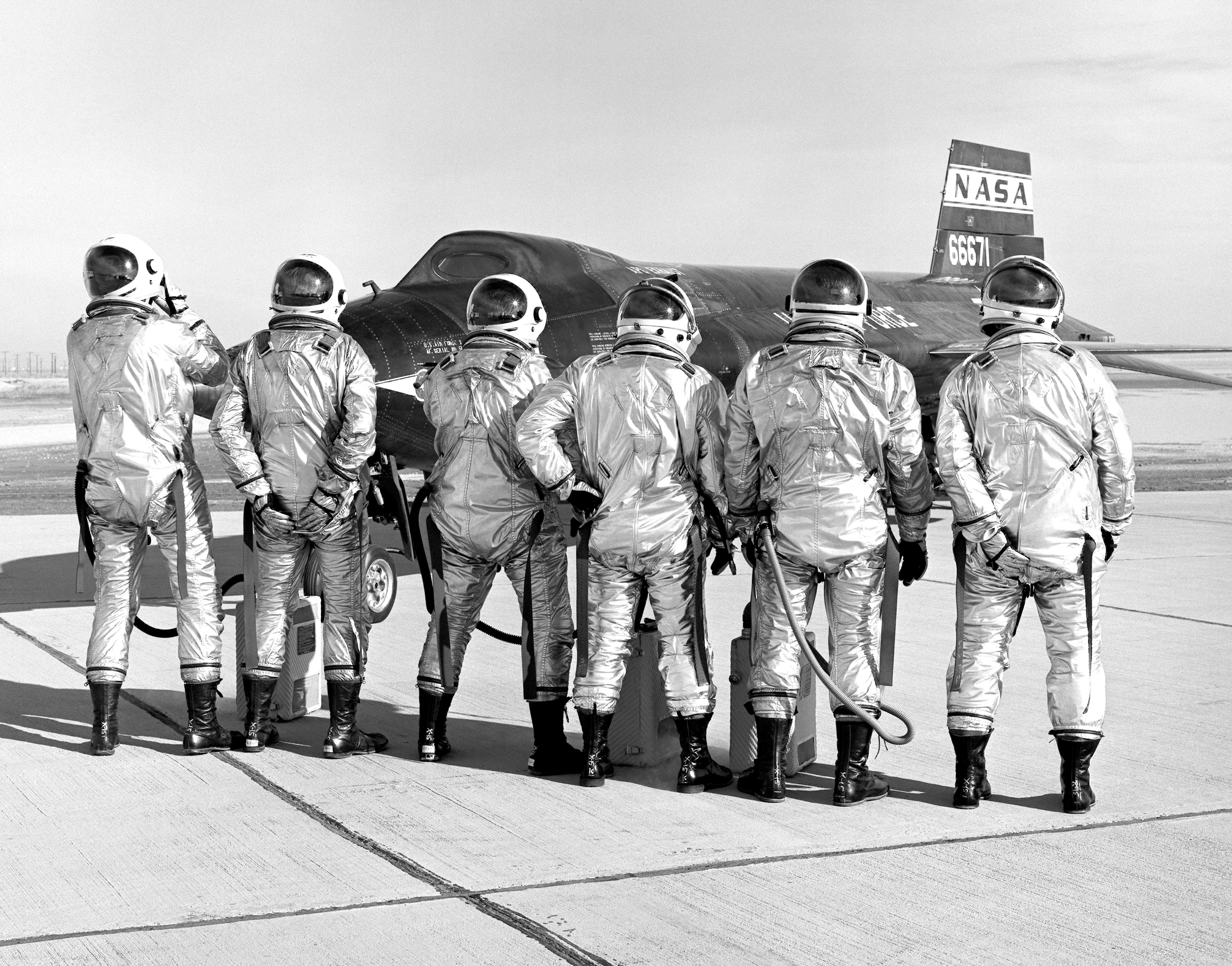 "The X-15 pilots clown around in front of the #2 aircraft. From left to right: USAF Capt. Joseph Engle, USAF Maj. Robert Rushworth, NASA test pilot John ""Jack"" McKay, USAF Maj. William ""Pete"" Knight, NASA test pilot Milton Thompson, and NASA test pilot William Dana."