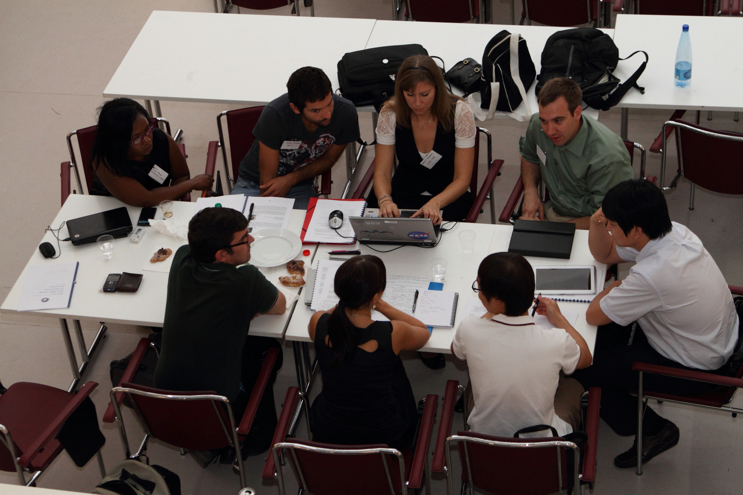 Delegates from South Korea, Italy, France, South Africa, and the United States discuss what motivates young professionals in the space industry at the inaugural IPMC Young Professionals Workshop in Naples, Italy on September 28, 2012.
