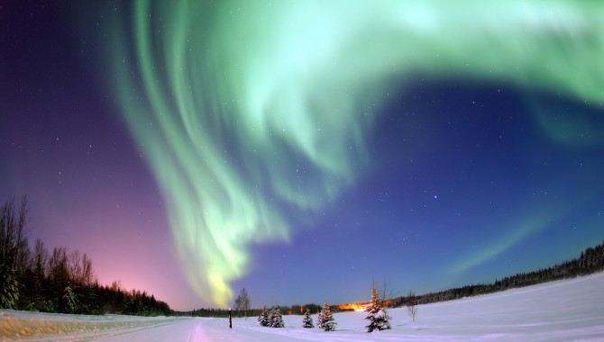 Above Bear Lake, Alaska, the Northern Lights, or aurora borealis, are created by solar radiation entering the atmosphere at the magnetic poles. The appearance of these lights is just one way solar radiation affects us; it can also interfere with NASA missions in low-Earth orbit. To achieve long-duration human spaceflight missions in deeper space, several NASA centers are working to find better safety measures and solutions to protect humans from space radiation.