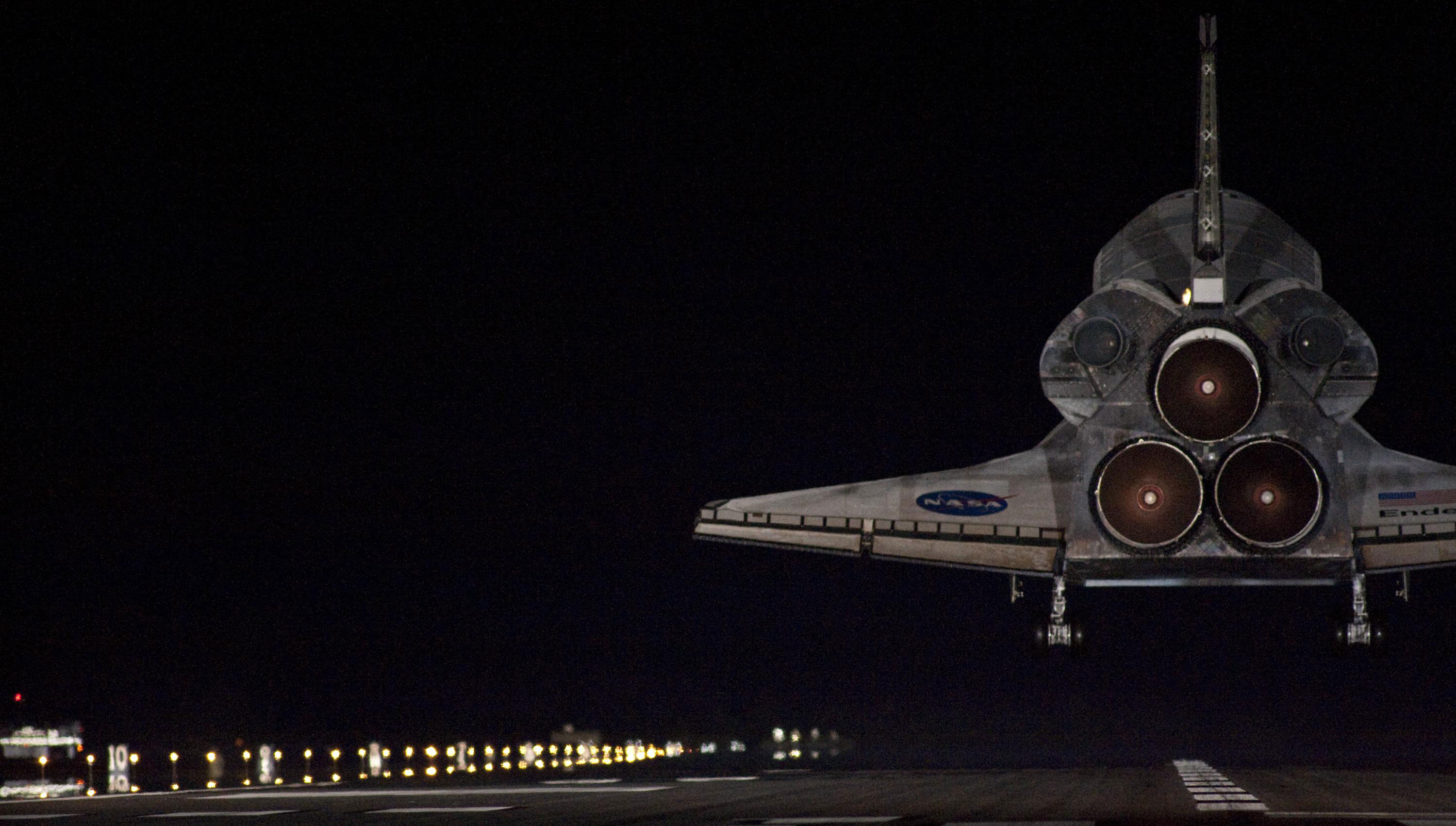 Endeavour touches down in darkness at NASA's Kennedy Space Center in Florida after 14 days in space.