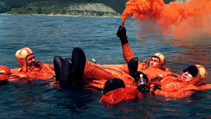 The first International Space Station crew, from left Soyuz Commander Yuri Gidzenko, Flight Engineer Sergei Krikalev and International Space Station Commander Bill Shepherd, practice water survival skills in the Black Sea recently. The skills would be needed in the event a Soyuz spacecraft landed in the water rather than on land as is normal. The crew is scheduled to launch to the new station in January 1999 aboard a Russian Soyuz spacecraft.