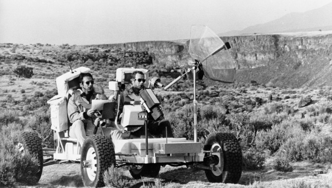 """""""Dave Scott (right) and Jim Irwin (left) drive the Geologic Rover ( aka Grover) along the rim of the Rio Grande Gorge at Taos, New Mexico. At this location, the Rio Grande Gorge is about the same width as Hadley Rille at the Apollo 15 landing site. During this training exercise, Dave and Jim conducted a geologic investigation similar to the one they later did at Hadley. Ulli Lotzmann notes that the 1g trainer was also known as the Geology Rover or Grover."""" Credit: NASA"""