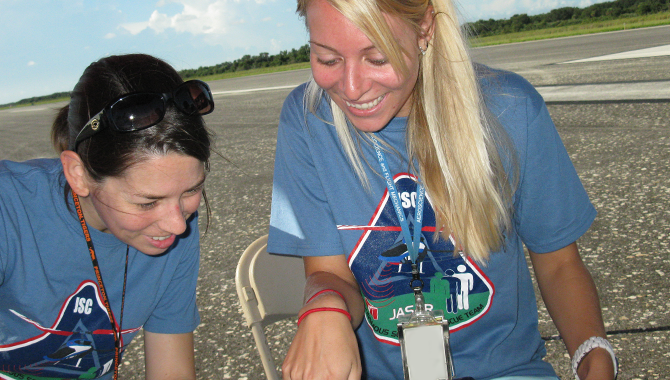 After the JSC team finished their first flight, team members Sara Scarritt and Rebecca Johanning review their results and are thrilled to see that the image processing algorithm correctly identified one of the targets.