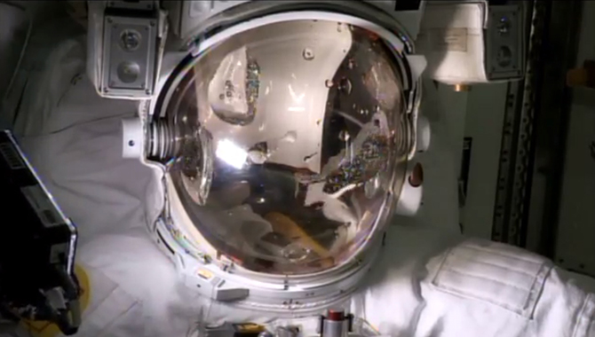 Water fills the empty spacesuit helmet of Italian astronaut Luca Parmitano in an Aug. 27, 2013 test of the faulty spacewalking gear which forced NASA to abort a July 16 spacewalk for safety reasons. The water leak confirmation will help NASA engineers devise repair methods for the spacesuit.