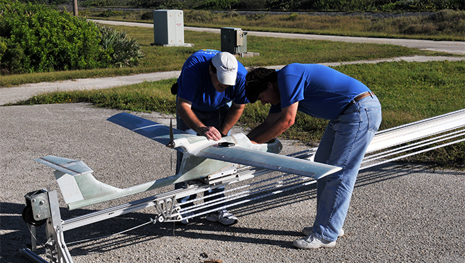 Les Boatright (left) and Mike Knutson (right) prepare Kennedy Space Center's Genesis aircraft for launch.