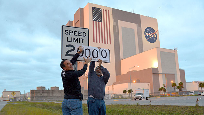 Orion engineers Stu McClung (left) and Ed Strong (right) update the speed limit at Kennedy Space Center for Orion's first flight, EFT-1. Photo Credit: NASA