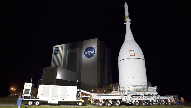 Orion in front of the Kennedy Space Center Vehicle Assembly Building before being mounted on its launch vehicle, the Delta IV Heavy rocket. Photo Credit: NASA/Frankie Martin