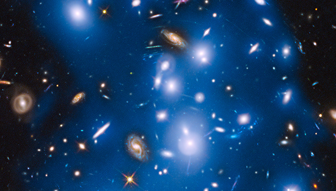 The ghostly glow of stars from galaxies torn apart billions of years ago, as observed recently by the Hubble Space Telescope. Photo Credit: NASA/ESA/IAC/HFF Team, STScI