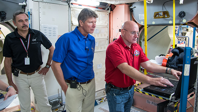 Mikhail Kornienko (left) and Scott Kelly (right) with Russian cosmonaut Gennady Padalka. Padalka will join Kelly and Kornienko for the first six months of their mission. Photo credit: NASA/James Blair