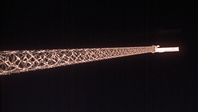 An antenna at the end of the 200-foot mast extending from the Endeavour facilitated 24-hour mapping of the globe. The mast was the longest rigid structure ever deployed from the shuttle. Photo Credit: NASA