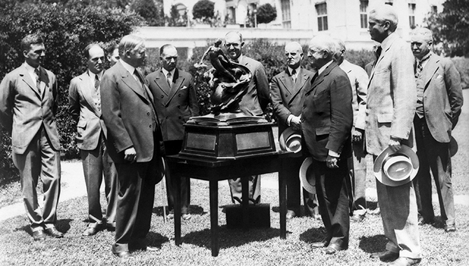 President Herbert Hoover presents the NACA's first Collier Trophy in 1929. Photo Credit: NACA